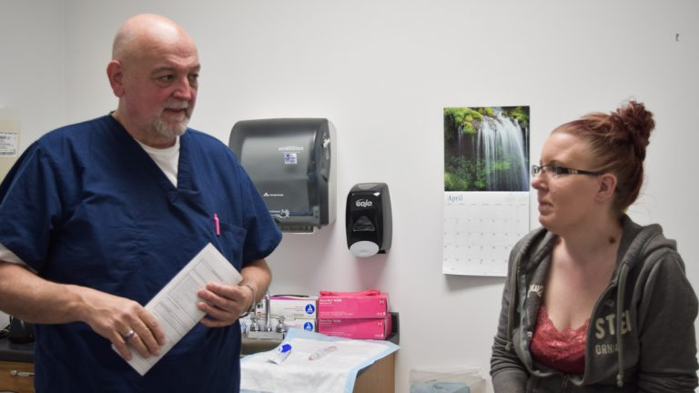 Dr. John Zimmerly reassures one of his pregnant patients, Kim. (Elizabeth Fiedler/WHYY)