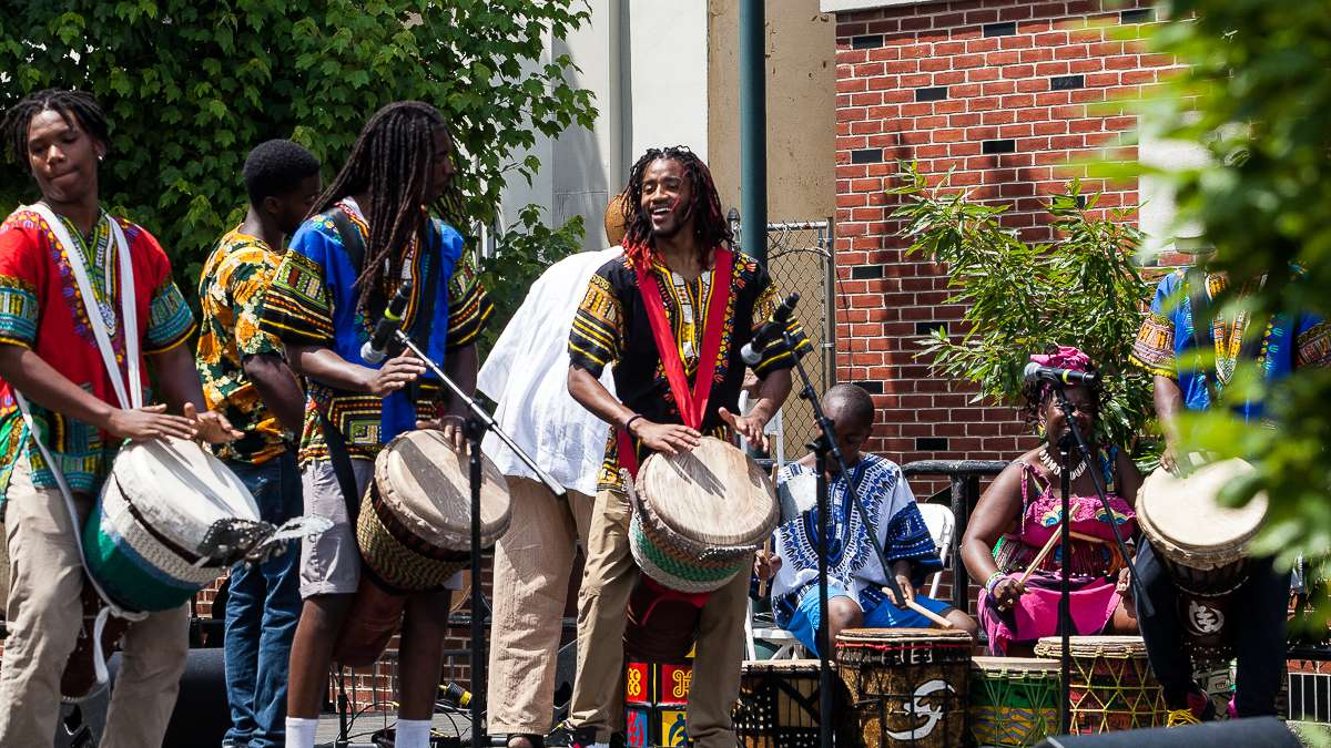 The African Heritage group from Washington, D.C., plays a traditional drum call during the Odunde Festival. Founded by Melvin Deal (not pictured) the group has performed at every Odunde Festival with varying members throughout the years. (Brad Larrison/for NewsWorks)