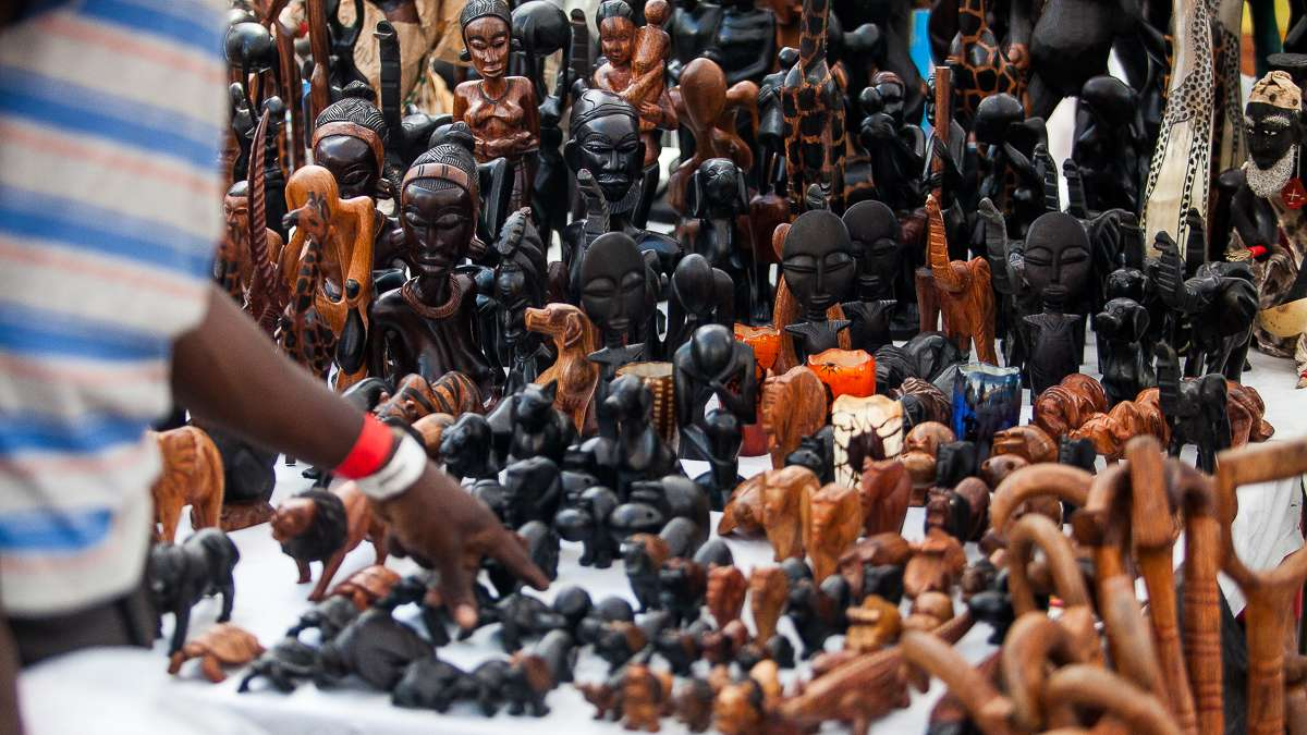 An array of hand-carved wooden statues and figurines are on display in the marketplace at the Odunde Festival. (Brad Larrison/for NewsWorks)