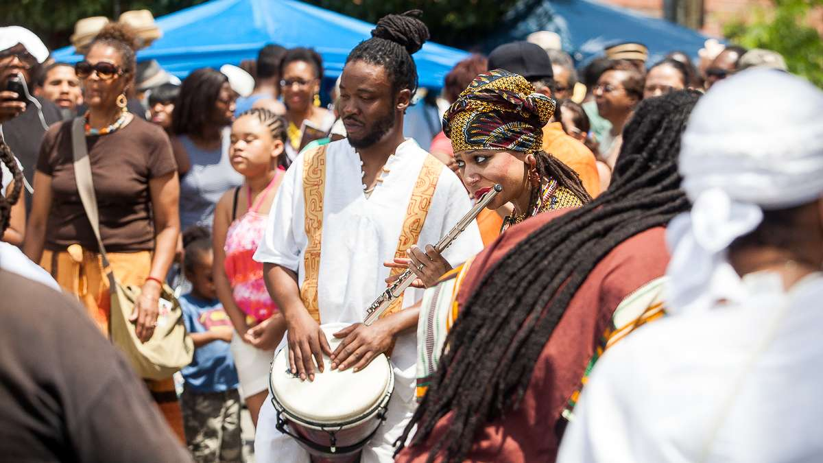Musicians play before the start of a procession to the Schuylkill River during the Odunde Festival. (Brad Larrison/for NewsWorks)