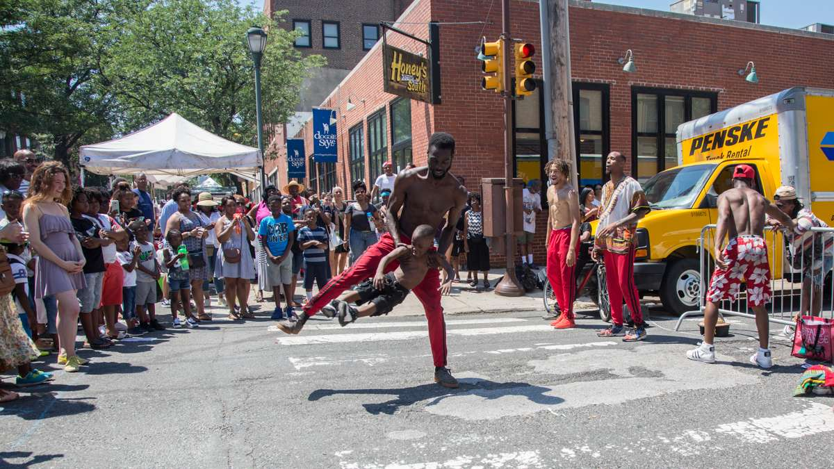 Antiwane Freeman, of Dancers Inspired Visions United, dances with his son A'shan, 5, during the 42nd Annual Odunde Festival.