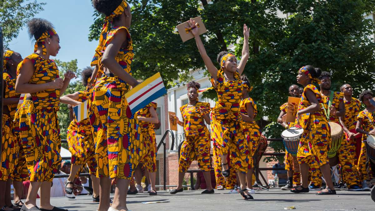 African Heritage Dancers and Drummers dance and play during the 42nd Annual Odunde Festival in Philadelphia. The dance group has performed at every festival since 1975.