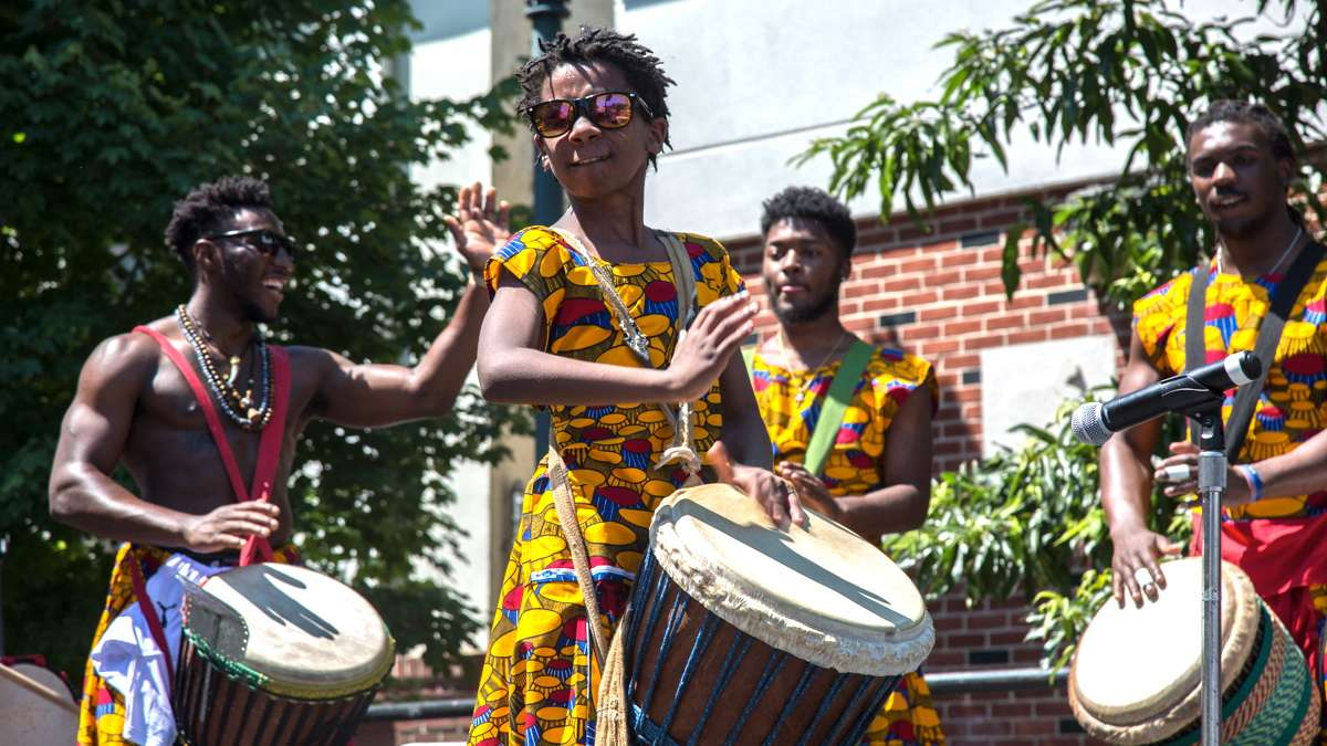 African Heritage Dancers and Drummers performer Kofi Hunt, 11, plays during the 42nd Annual Odunde Festival in Philadelphia. The dance group has performed at every festival since 1975.