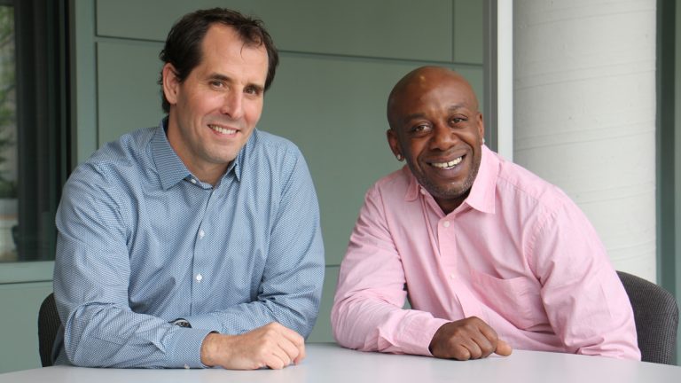 Mike Brady (left), CEO of Greyston Bakery and one of his employees, Dion Drew. (Emma Lee/WHYY)
