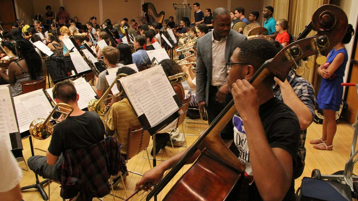 In a crowded practice room at the Kimmel Center, Philadelphia's All City Orchestra rehearses in preparation for a trip to Italy. (Emma Lee/WHYY)