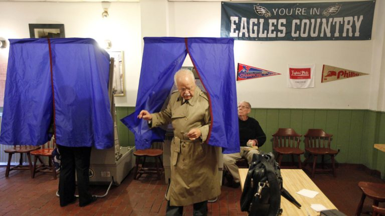 A voter steps out of the voting booth at a polling station in Philadelphia. (AP Photo/Matt Rourke, file)