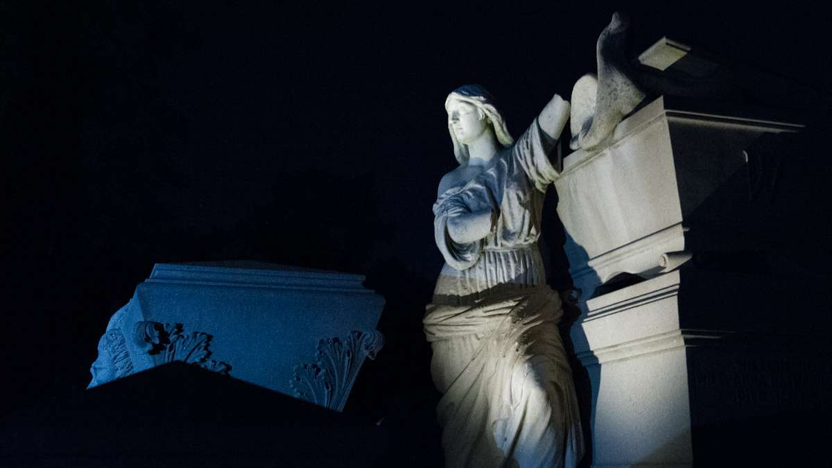 One of the cemetery's most noted sites is the Warner Monument, here illuminated with painted light. The monument was the work of Philadelphia sculptor Alexander Milne Calder, who also created the statue of William Penn that stands atop Philadelphia City Hall.
