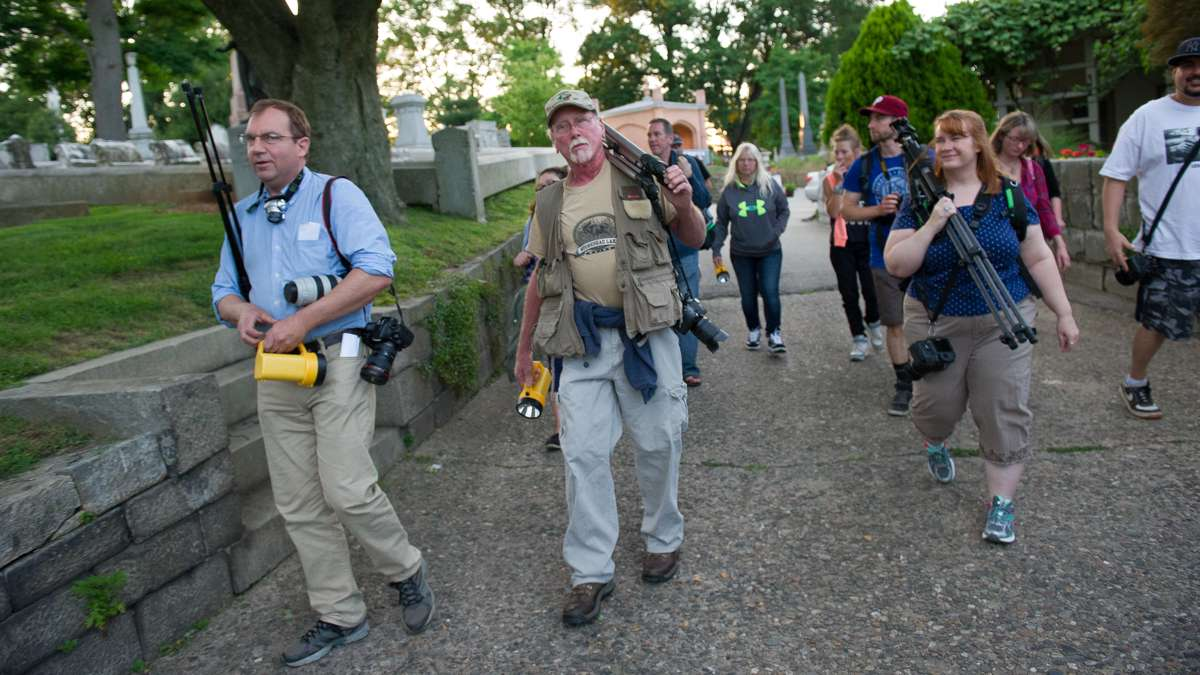 Laurel Hill Grounds Foreman Frank Rausch (second from left) leads more than a dozen photo enthusiasts through the cemetery at the start of the Lunar Stroll.