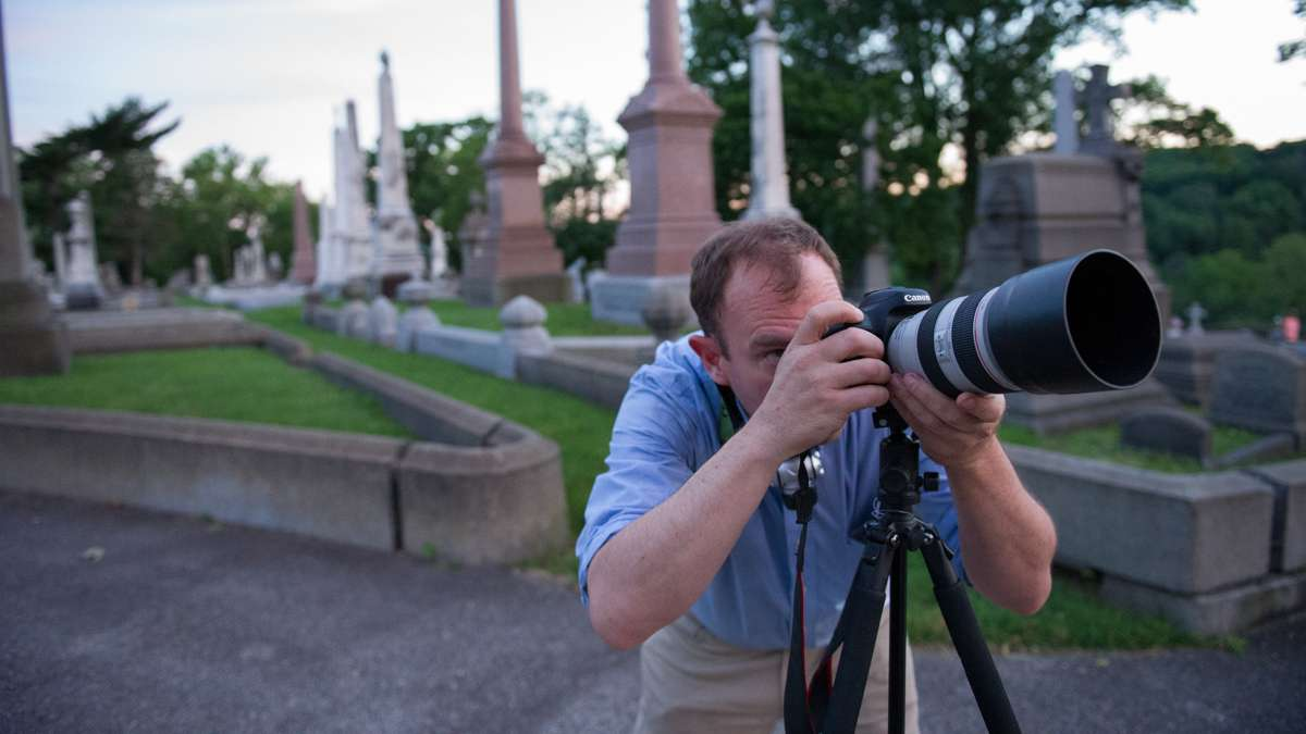 Michael Litchman trains his lens on one of the cemetery's monuments at sunset.