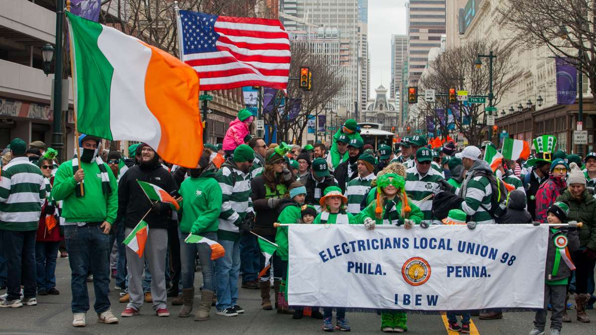 Members of Electricians Local Union 98 and their families march in the Saint Patrick's Day Parade on Market Street Sunday.