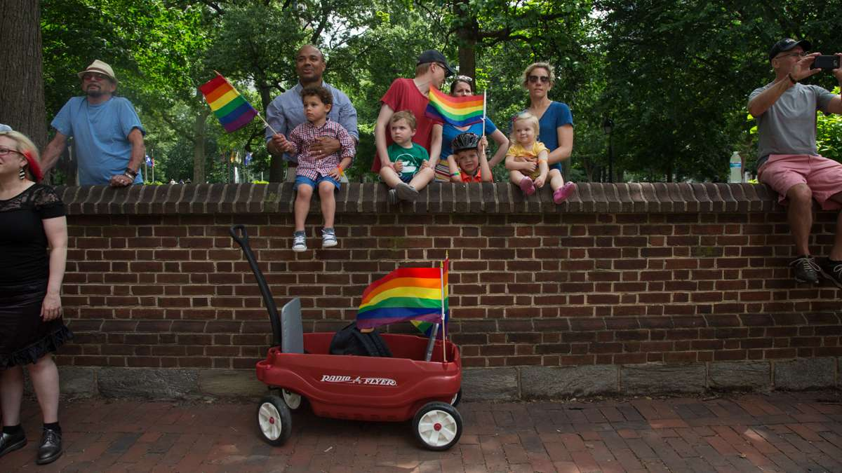Families gather to watch the Philadelphia Pride Parade Sunday, June18, 2017.