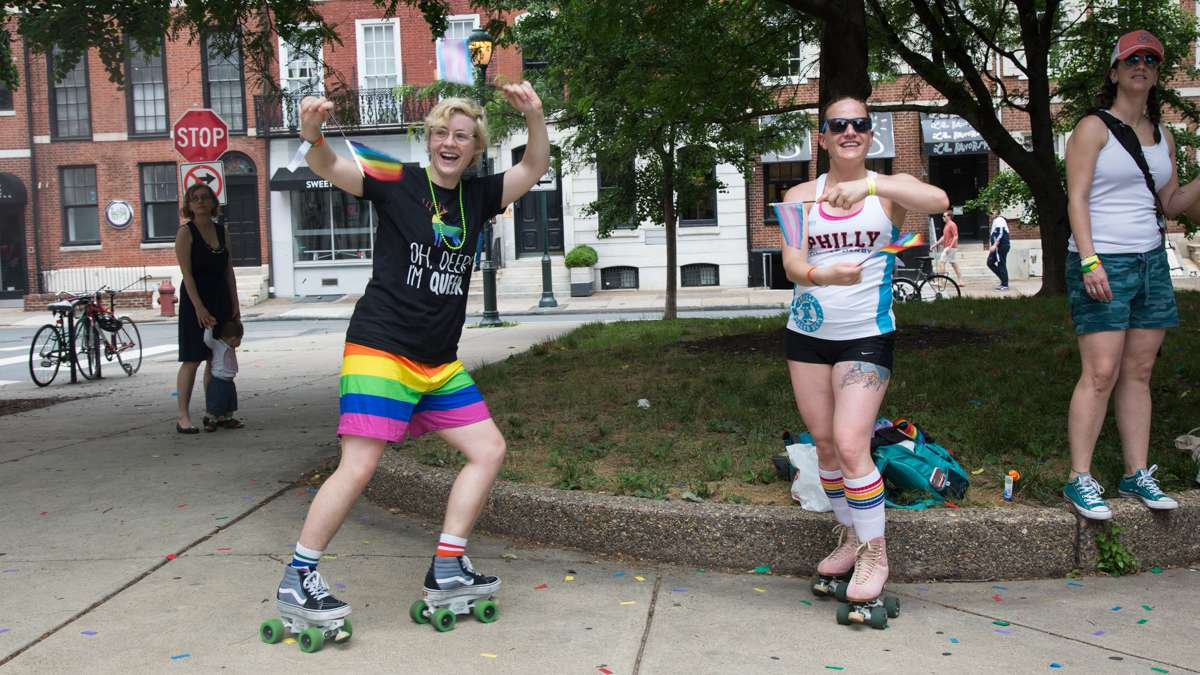 Emily Erdman, 26, and Mandi Marino, 33, skate alongside the 2017 Philadelphia Pride Parade with their Philly Roller Derby team, Sunday, June 18, 2017.