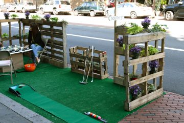 Relaxing after a one hole course. International Park(ing) Day pop up. (Charlie Kaier/WHYY)