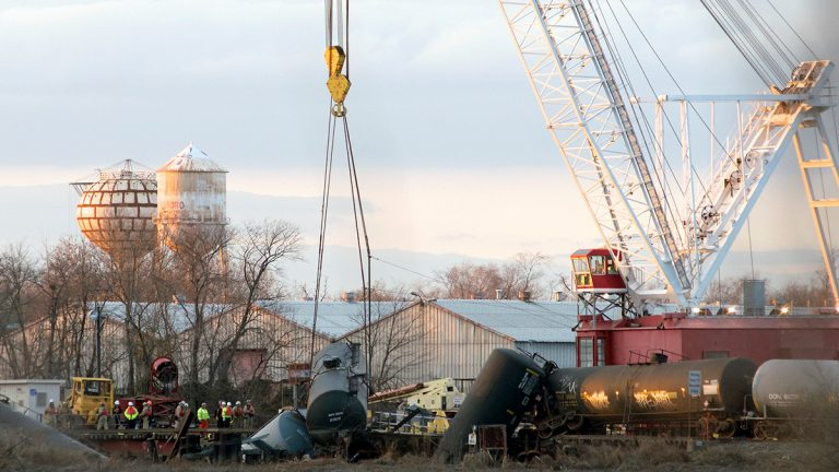 A crane lifts up the first car at the derailment site in Paulsboro, NJ., in December (Bas Slabbers/for NewsWorks, file)
