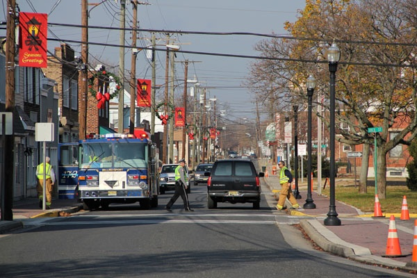 <p>Delaware Avenue is decorated for the holidays, but a 12-block area of the town is off-limits because of a chemical spill. (Emma Lee/for NewsWorks)</p>