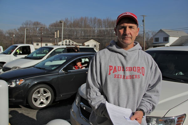 <p>With schools closed because of a chemical spill, Paulsboro High School principal and wrestling coach Paul Morina organizes a practice in Gibbstown. (Emma Lee/for NewsWorks)</p>