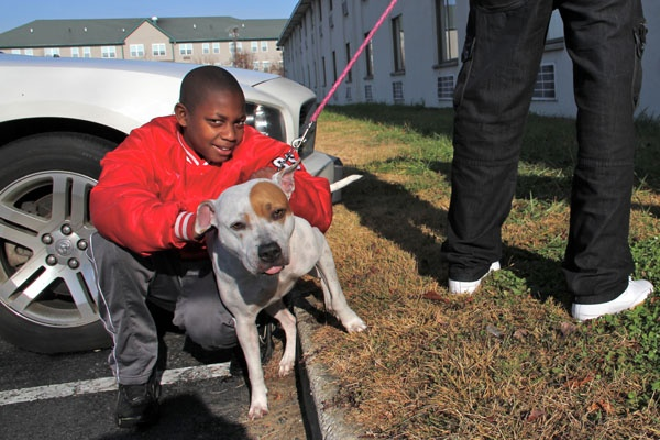 <p>Isaiah Generette is staying at the Motel 6 off I-295 in Swedesboro with his mother, stepfather, and their dog, Dream, while their home on East Adams Street in Paulsboro is under evacuation. (Emma Lee/for NewsWorks)</p>