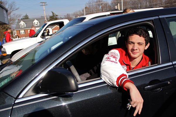 <p>Despite a shelter-in-place warning, John Gentile and other members of the Paulsboro High School wrestling team gather in a parking lot in Gibbstown while their coach tries to find a place for them to practice. (Emma Lee/for NewsWorks)</p>