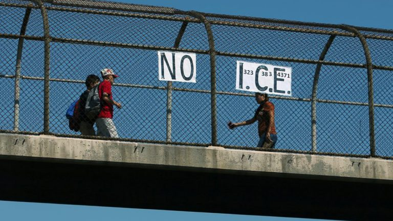 A 'NO I.C.E.' (U.S. Immigration and Customs Enforcement) sign seen on a pedestrian overpass crossing a freeway in Los Angeles, California. (Mike Blake/Reuters)