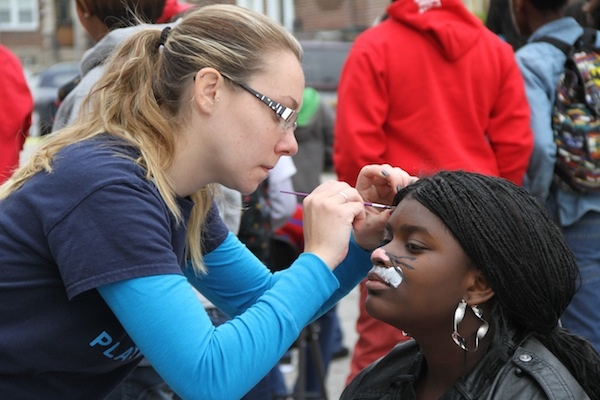 <p><p>Volunteers paint faces at the fall festival. (Trenae V. McDuffie/for NewsWorks)</p></p>
