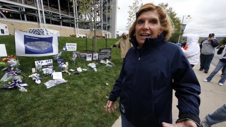 Gayle Barnes, a member of the sequestered jury that convicted former Penn State assistant football coach Jerry Sandusky, stands outside Beaver Stadium on Saturday, Oct. 6, 2012 in State College, Pa. (AP Photo/Gene J. Puskar)