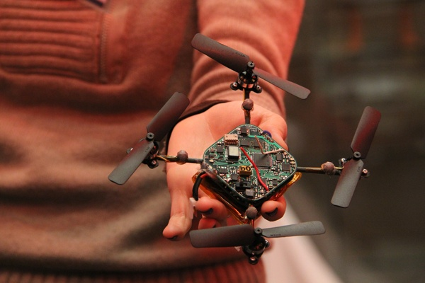 <p>Penn student Katy Powers holds a quadrotor robot. The agile flying robots are capable of sensing each other and working in teams. (Emma Lee/for NewsWorks)</p>