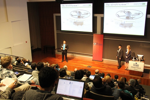 <p>The winners of the Y Prize competition present their plan to use flying quadrotor robots to detect buried explosive devices. (Emma Lee/for NewsWorks)</p>