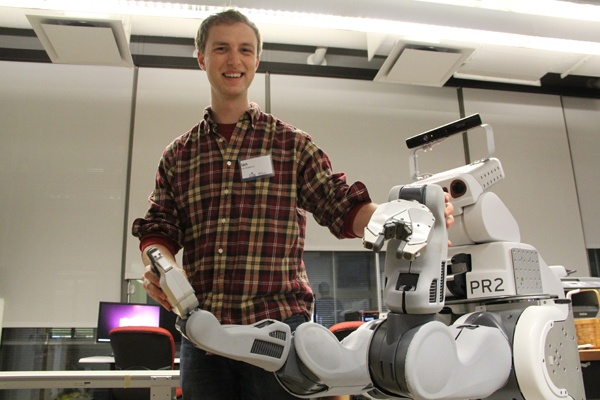 <p>Penn student Ian McMahon manipulates a PR2 robot, sometimes used in assembly line work. (Emma Lee/for NewsWorks)</p>
