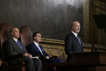 Gov. Tom Wolf (right) delivers his budget address for the 2015-16 fiscal year to a joint session of the Pennsylvania House and Senate on March 3, 2015, in Harrisburg, Pa. Speaker of the House of Representatives, Rep. Mike Turzai, R-Allegheny, is at left, and Lt. Gov. Michael Stack, is at center. (AP Photo/Matt Rourke)