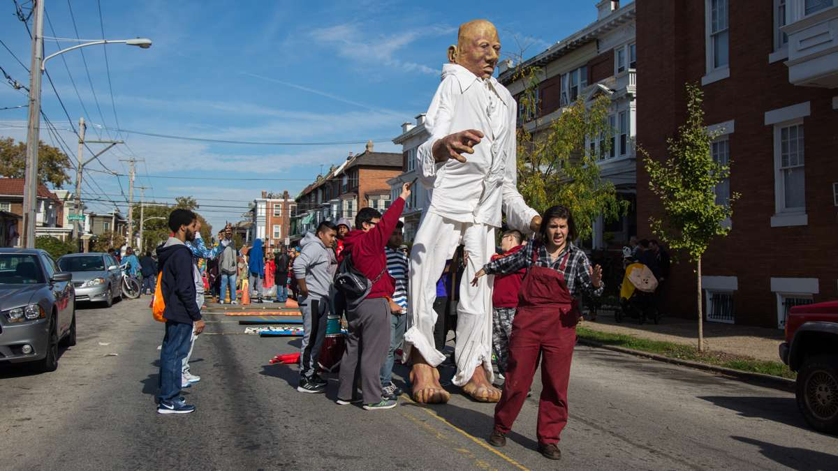 Rachel Adler, from Spiral Q, teaches with teenagers from the Youth Volunteer Corps how to make the giant puppet appear to be walking. The theme for this years annual Peoplehood parade was ''We might all be giant.''