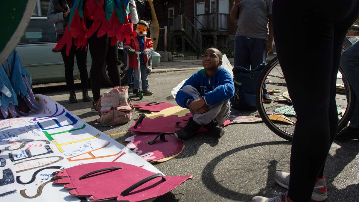 Asa Morrison, 10, discusses which issues matter to him at the Neighborhood Bike Works set-up spot before the 17th annual Peoplehood parade in West Philadelphia, October 29th 2016.