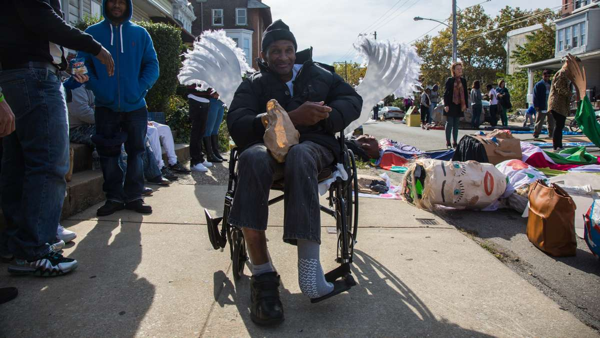 Dennis Cook sits in a chair decorated with angel wings to show of his support and gratitude to the organization Angels in Motion, which works with substance abusers and helps them get treatment.