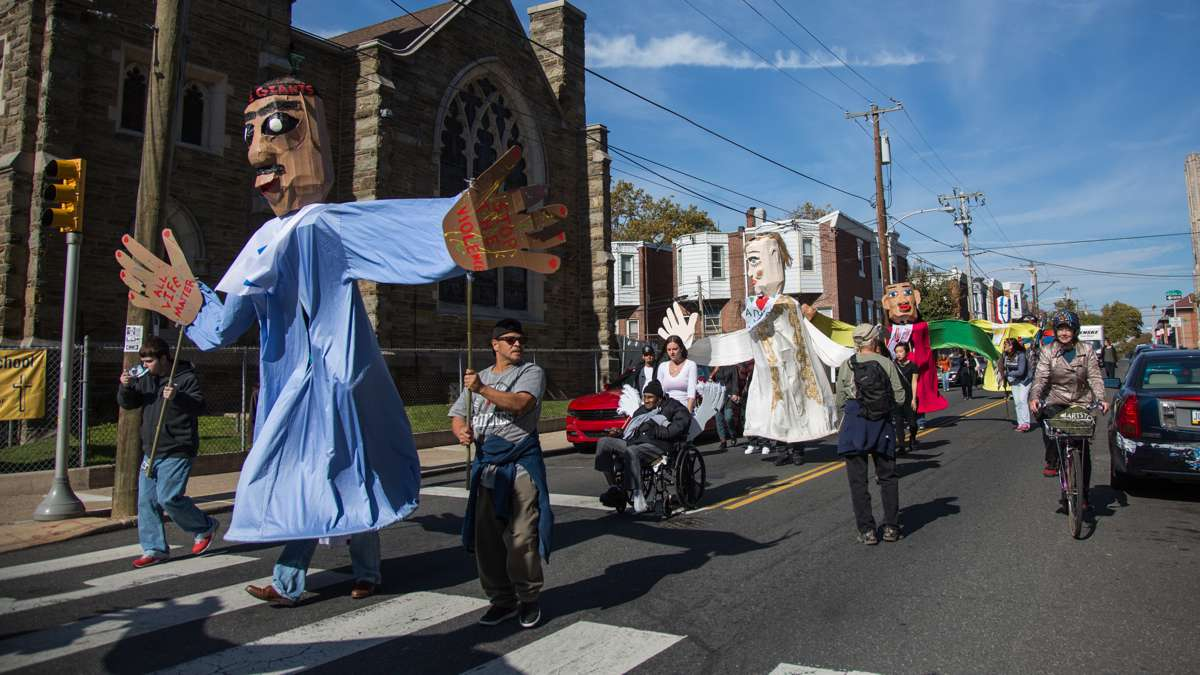 Representatives of Girard Medical Center carry the giant puppets they created for the 17th annual Peoplehood parade Oct. 29, 2016.