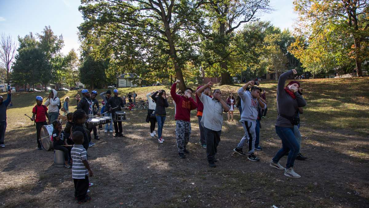 Marchers dance at Clark Park at the end of the 17th annual Peoplehood parade, Oct. 29, 2016.