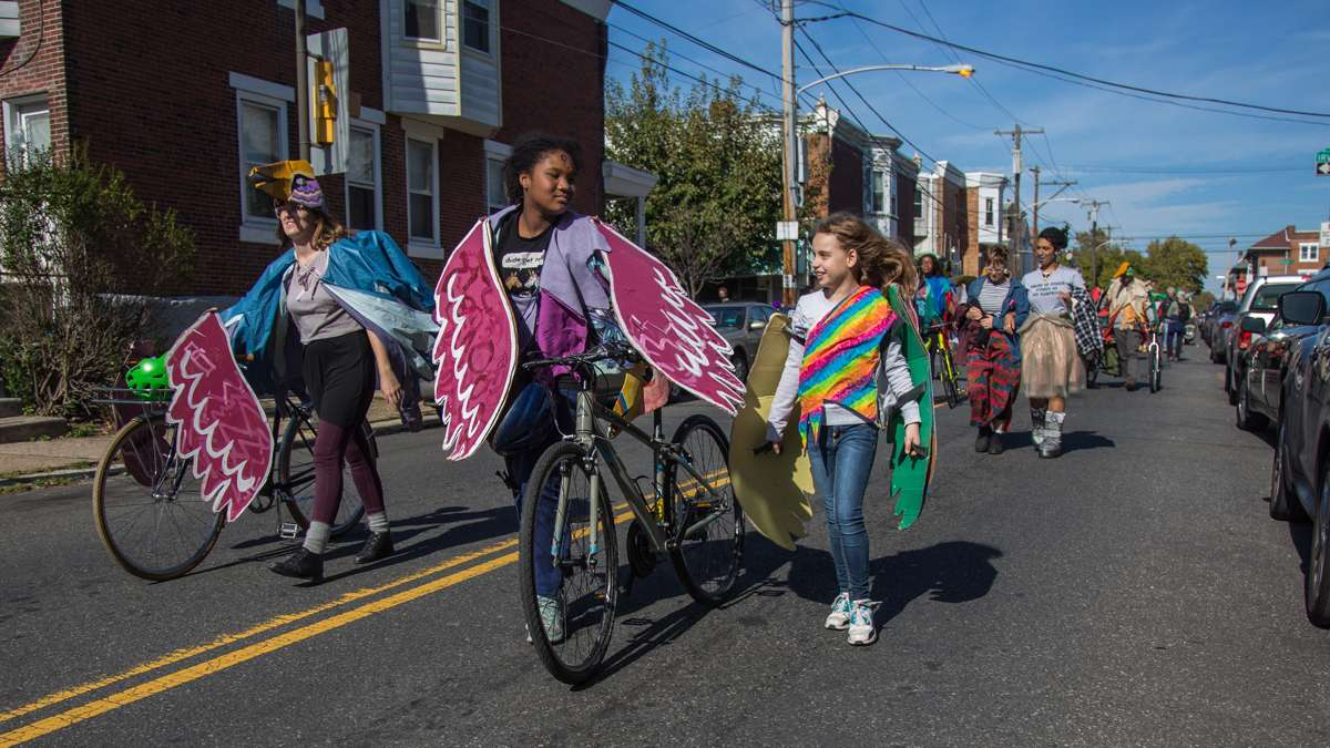 Young people from Neighborhood Bike Works chat as the 17th annual Peoplehood parade makes its way through West Philadelphia October 29th 2016.