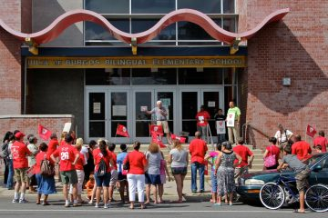 A rally at DeBurgos Elementary School draws about 60 parents, students and educators. The rally is the first of several that the teachers' union plans to hold at different neighborhood schools throughout the city. (Emma Lee/for NewsWorks)