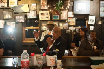 Mayoral candidate Milton Street answers a question from a patron at Billy Murphy's Irish Saloon Tuesday night, during its weekly quizzo event. Questions focused on public schools, his position on charters, and why he is running for mayor.