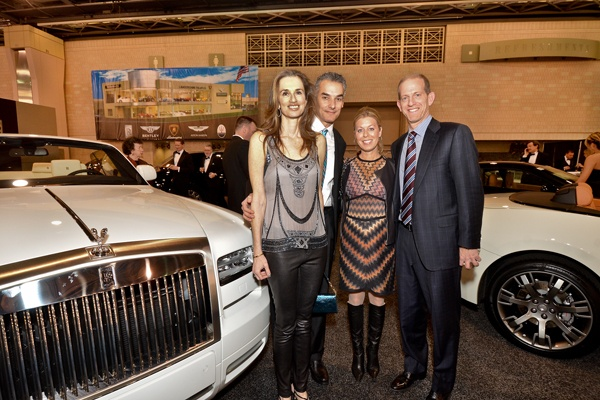 <p><p>Black Tie Tailgate committee members Amy and Marc Brownstein (left), with Jill and Eric Sussman of Sussman Automotive, beside a Rolls Royce Phantom Drophead Coupe, the most expensive vehicle at the Auto Show at $504,530 (Photo courtesy of Marc Barag, MB Commercial Photography)</p></p>