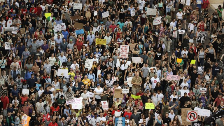 Protesters march down North Broad street in Philadelphia, Wednesday, Aug. 16, 2017, in response to a white nationalist rally held in Charlottesville, Va., over the weekend. (AP Photo/Matt Slocum)