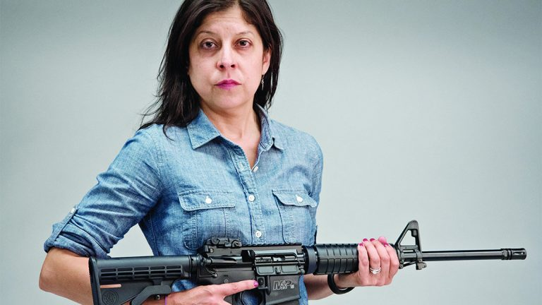 Daily News columnist Helen Ubinas with a newly purchased AR-15 semiautomatic rifle on Monday (Photo by  Aaron  Ricketts/Daily News Staff Photographer)