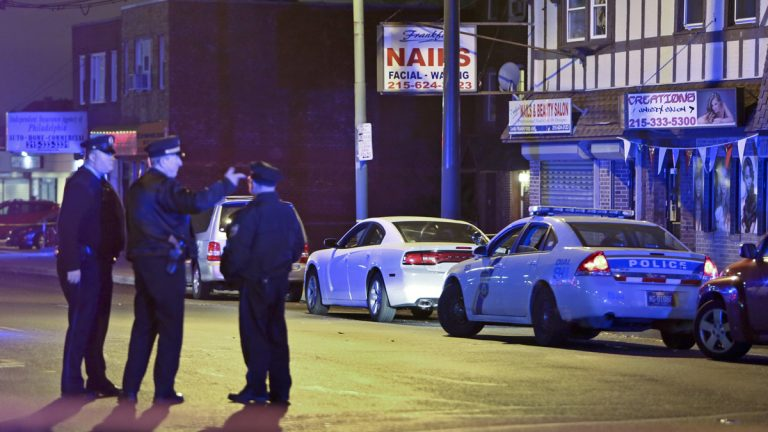 Investigators gather at the crime scene in the Mayfair section of Philadelphia, Monday Dec. 15, 2014, after an officer fired their weapons at a man. (AP File Photo/ Joseph Kaczmarek)