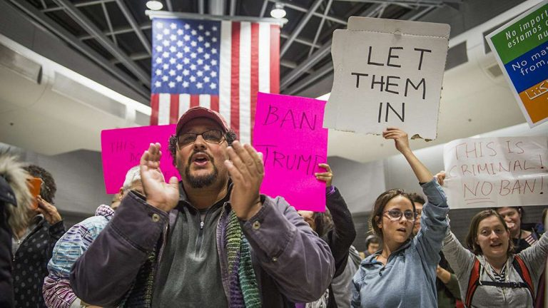 Protesters angered by President Donald Trump's executive order that prevented refugees, visa and green card holders from entering the US chant pro-immigration slogans at Philadelphia International Airport.
