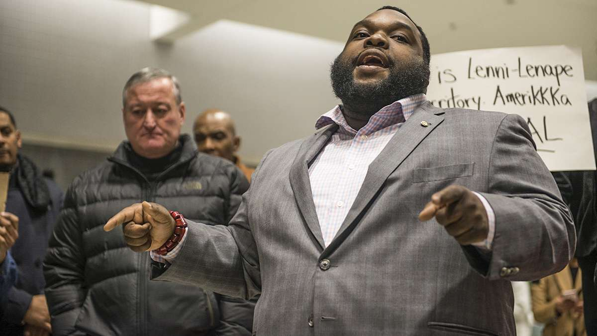State Rep. Jordan Harris speaks to protesters and media about the developing situation regarding President Donald Trump's executive order on immigration at the Philadelphia International Airport. (Branden Eastwood for NewsWorks)