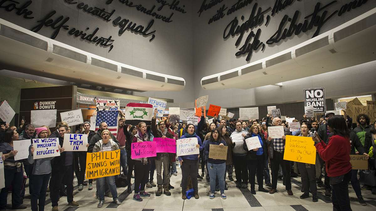 Protesters angered by President Donald Trump's executive order that prevented refugees, visa and green card holders from entering the US chant pro-immigration slogans at Philadelphia International Airport in January.