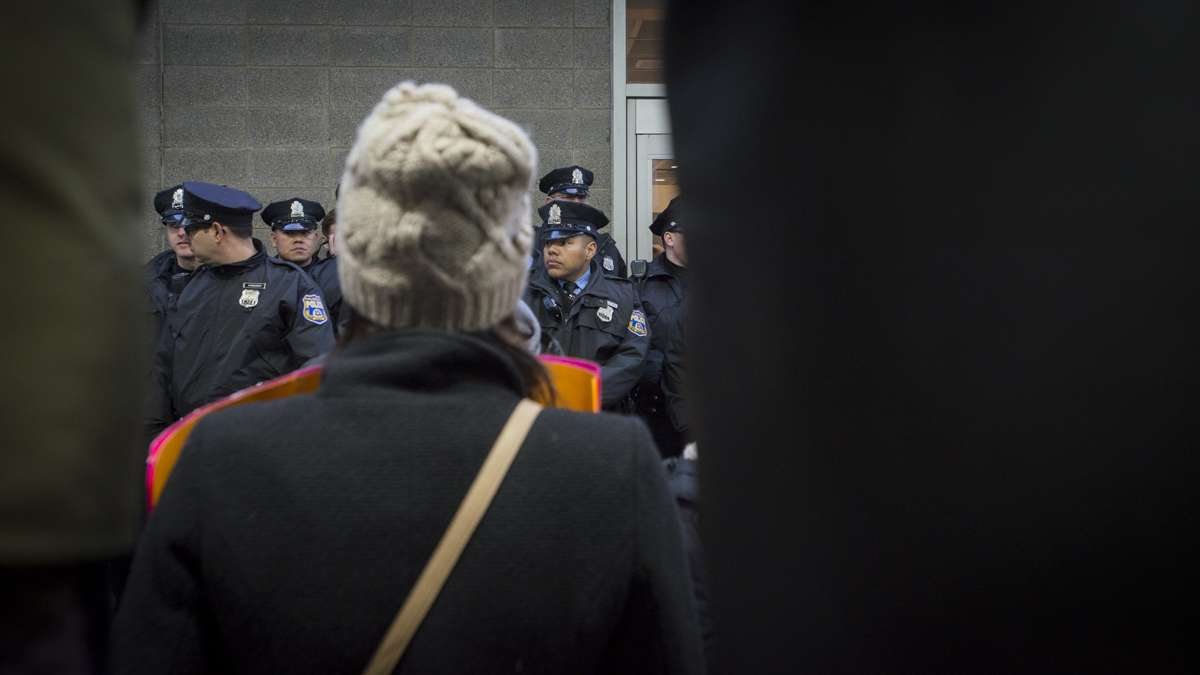 Police prevent protesters from entering the terminal at Philadelphia International Airport. (Branden Eastwood for NewsWorks)