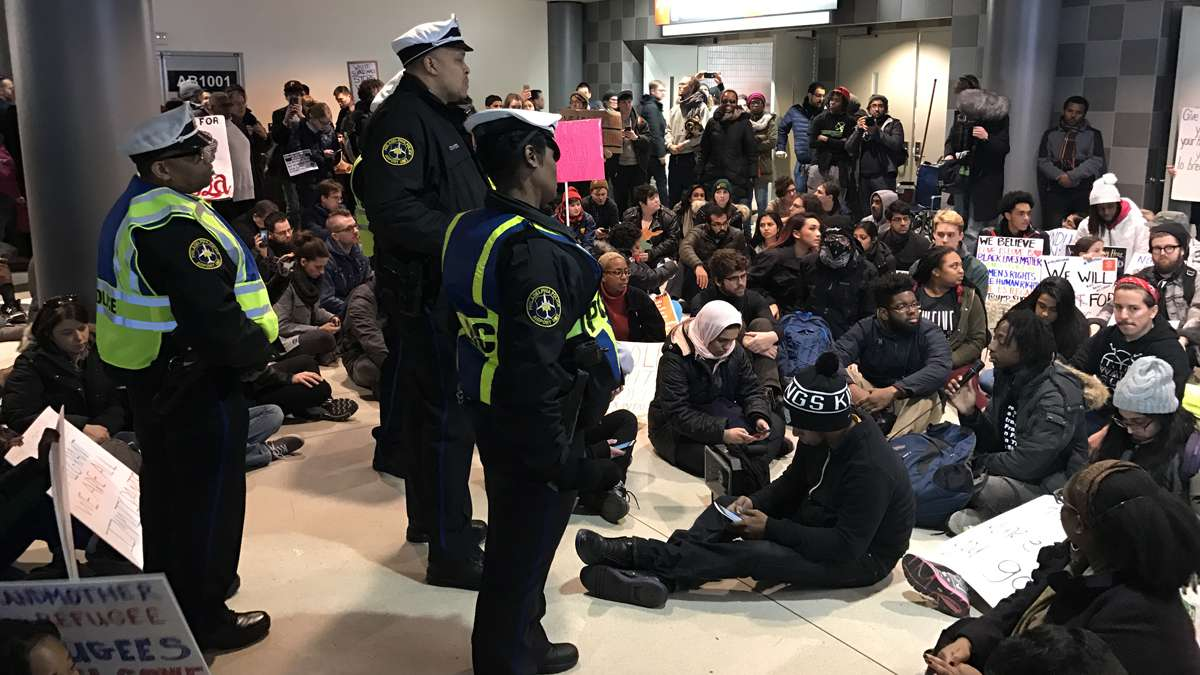 Scenes from the second day of actions at Philadelphia International Airport where people have come to protest President Trump's executive order detaining and deporting refugees. (Bastiaan Slabbers for NewsWorks)