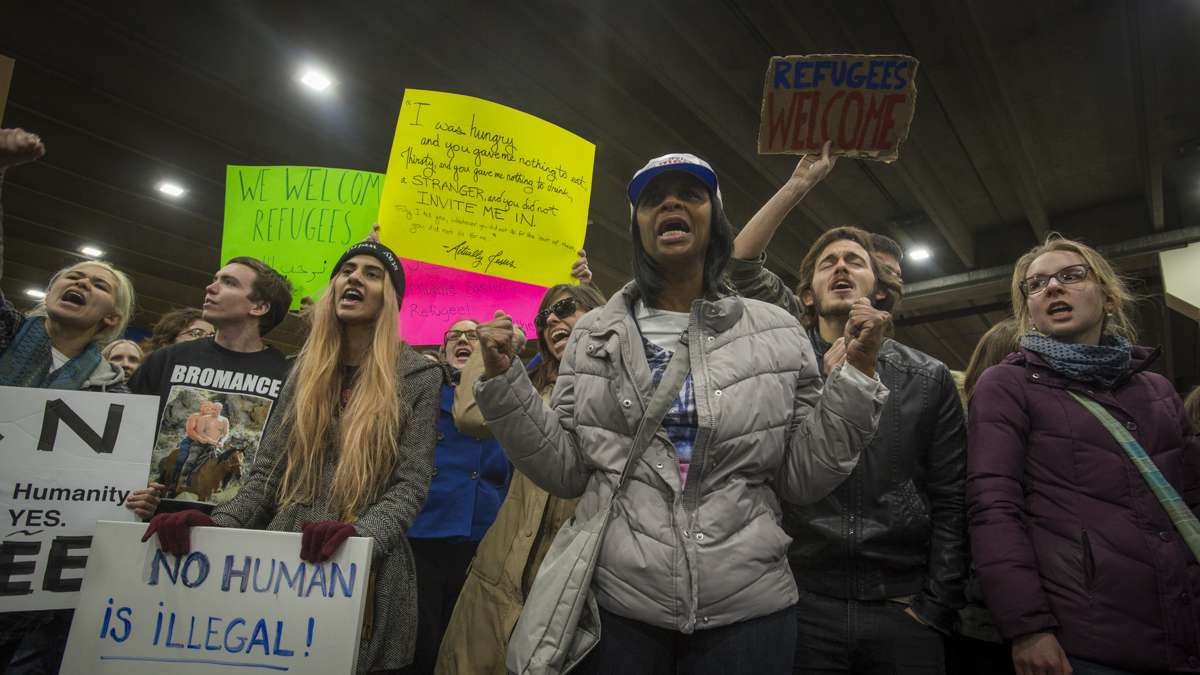 Protesters opposed to Donald Trump's executive order on immigration march outside of Terminal A at Philadelphia International Airport. (Branden Eastwood for NewsWorks)