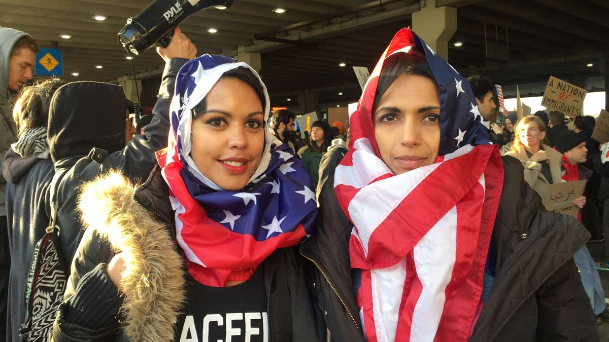 Scenes from the second day of actions at Philadelphia International Airport where people have come to protest President Trump's executive order detaining and deporting refugees. (Paige Pfleger/WHYY)