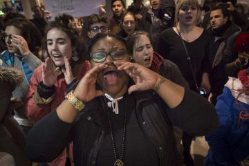 Protesters chant slogans inside the terminal at Philadelphia International Airport.