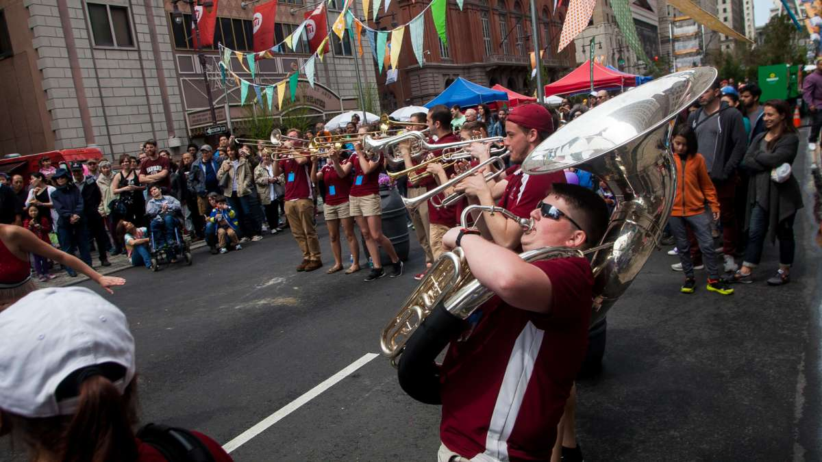 Members of Temple University's Cherry and White Band perform on Broad Street at the PIFA Street Fair.